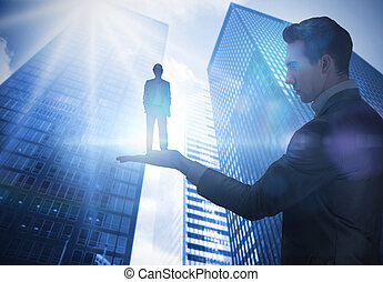 Composite image of businessman holding architect