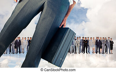 Composite image of businessman holding briefcase -...