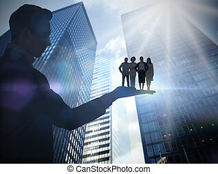 Composite image of businessman holding business team