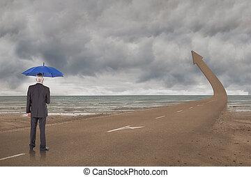 Composite image of businessman holding umbrella -...