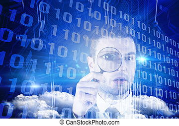 Composite image of businessman looking through magnifying ...