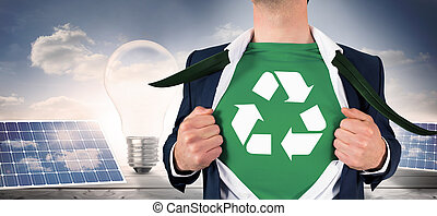 Composite image of businessman opening shirt in superhero ...