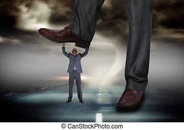 Composite image of businessman stepping on tiny businessman...