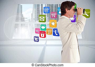Composite image of businessman using binoculars