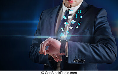 Composite image of businessman using hologram watch against...
