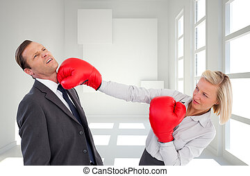 Composite image of businesswoman hitting colleague with her...