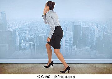 Composite image of businesswoman sh - Businesswoman shouting...