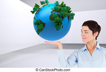 Composite image of businesswoman with an open hand to show a copy space against a white background