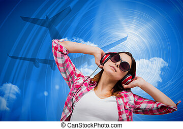 Composite image of casual brunette listening to music