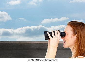 Composite image of charismatic businesswoman predicting...