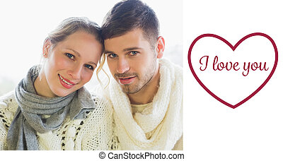 Composite image of close up portrait of a loving couple in winte