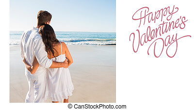 Composite image of content couple looking at the waves