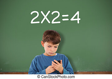 Composite image of cute boy using smartphone - Cute boy...