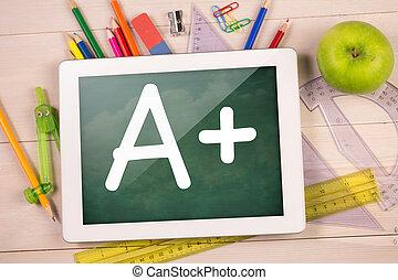Composite image of digital tablet on students desk showing a...