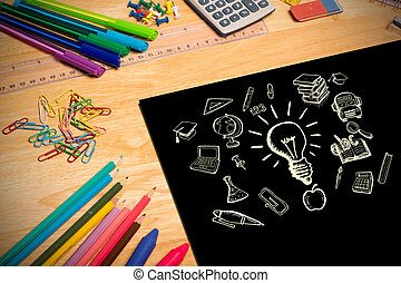 Composite image of education doodles against students desk