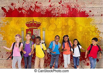 Composite image of elementary pupils running - Elementary...