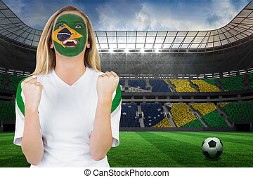 Composite image of excited brasil fan in face paint cheering...
