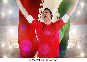 Composite image of excited football fan cheering holding iran fl