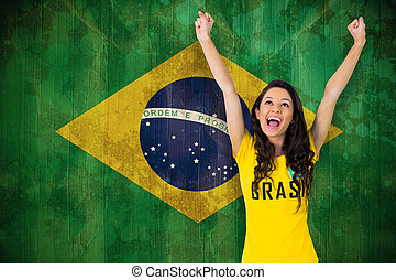 Composite image of excited football fan in brasil tshirt -...