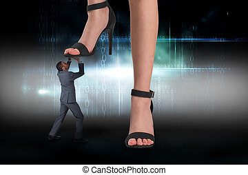 Composite image of female feet in black sandals stepping on...