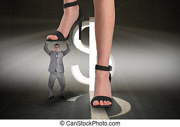Composite image of female feet in black sandals stepping on ...