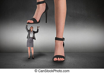 Composite image of female feet in black sandals standing on...