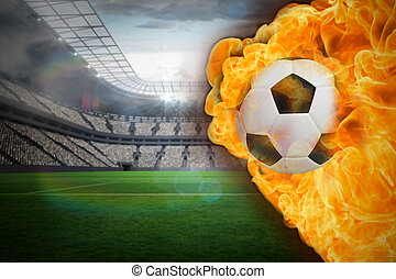 Composite image of fire surrounding football