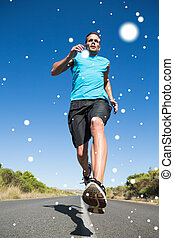 Composite image of fit man jogging on the open road