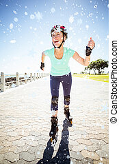 Composite image of fit mature woman rollerblading on the pier