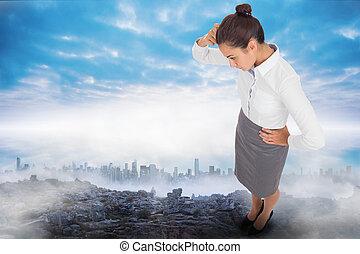 Composite image of focused businesswoman - Focused...