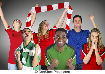 Composite image of football fans against grey vignette