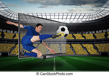Composite image of football player in blue kicking ball out...