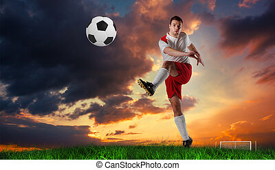 Composite image of football player in white kicking -...