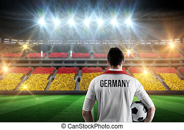 Composite image of germany football player holding ball - ...