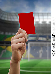 Composite image of hand holding up red card - Hand holding ...