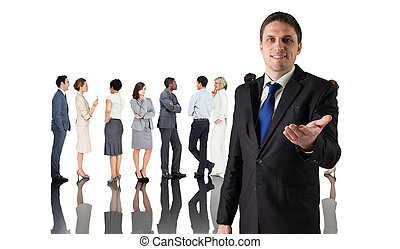 Composite image of handsome businessman holding hand out...