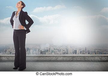 Composite image of happy businesswoman - Happy businesswoman...