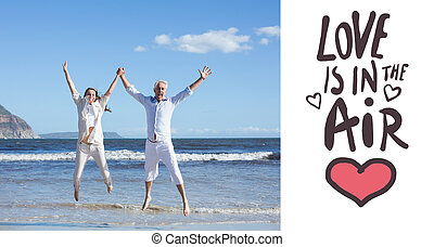 Composite image of happy couple jumping up barefoot on the beach
