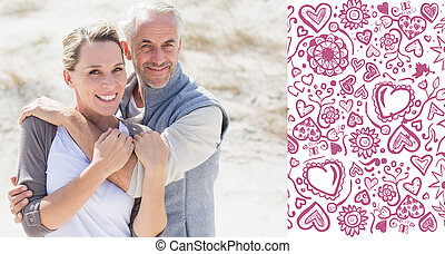 Composite image of happy hugging couple on the beach looking at