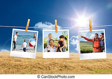 Composite image of instant photos hanging on a line against ...