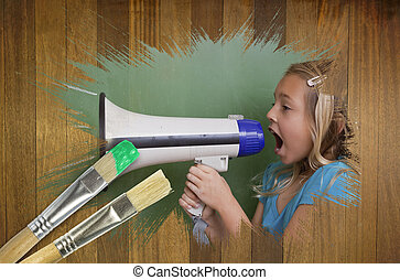 Composite image of little girl with bullhorn against wooden surface with paintbrush