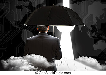 Mature businessman holding an umbrella against keyhole graphic on blue background