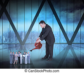 Composite image of mature businessman watering tiny business tea