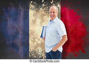 Composite image of mature student holding files - Mature...