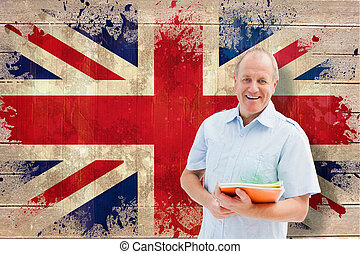 Composite image of mature student holding notebooks - Mature...