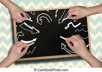 Composite image of multiple hands drawing arrows with chalk