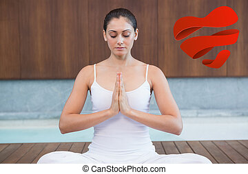 Composite image of peaceful woman in white sitting in lotus pose