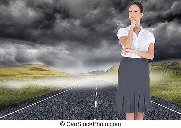 Composite image of pensive elegant businesswoman posing
