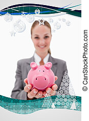 Composite image of piggy bank being offered by smiling bank empl