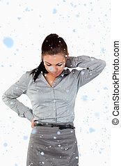 Composite image of portrait of a sad businesswoman having back p